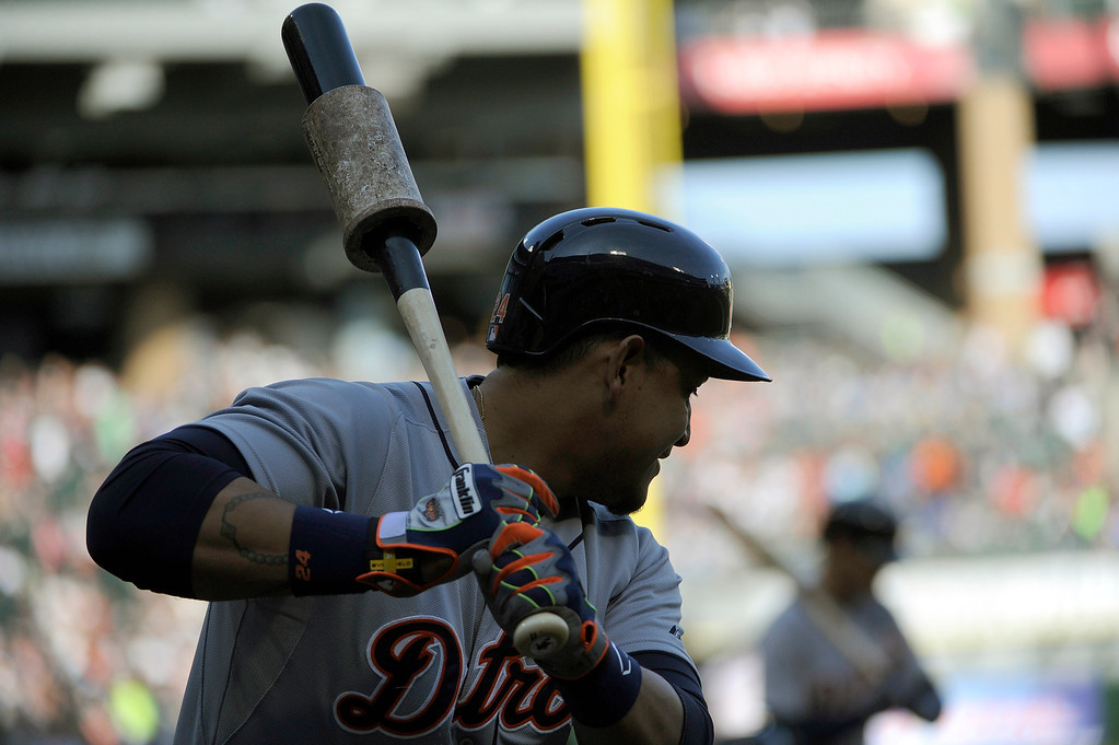 . Detroit Tigers\' Miguel Cabrera (24) warms up in the on deck circle against the Chicago White Sox during the first inning of a baseball game, Saturday, June 6, 2015 in Chicago.  (AP Photo/David Banks)