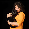 Black cat and owner photographed in studio