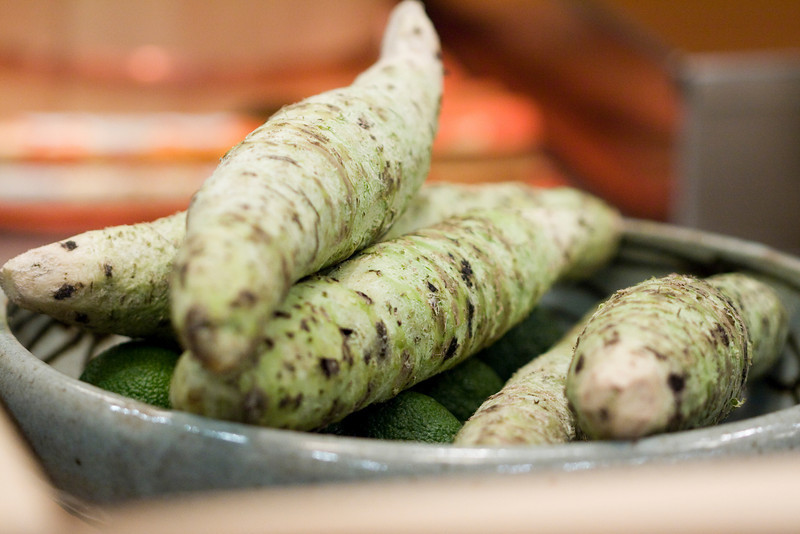 Wasabi root.  Hiro grates these to make real wasabi for the sushi.  There's no powered wasabi here.