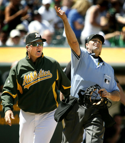 Oakland Athletics manager Bob Geren is thrown out of the game by home plate umpire Paul Nauert after protesting a third strike to Matt Holliday in the seventh inning in an MLB baseball game against the Toronto Blue Jays in Oakland, California, May 9, 2009.  (AP Photo/Dino Vournas)