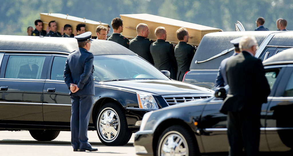 . Dutch military personnel carry coffins containing the remains of the victims of the MH17 plane crash to a waiting hearse at the airbase in Eindhoven on July 24, 2014. Two planes carrying a total of 74 coffins landed at Eindhoven in the south of the country, from where they are to be taken to a military barracks in Hilversum, near Amsterdam, for forensic examination and identification. The Netherlands lost 193 citizens in the crash, and is also heading the investigation of the other dead from a total of 11 countries. Dutch police said that 80 forensic experts from Germany, Belgium, Britain, Australia, Indonesia, New Zealand, and Malaysia were helping 120 Dutch with the task of identification, which could take months.   AFP PHOTO /  ANP / ROBIN VAN LONKHUIJSEN /AFP/Getty Images