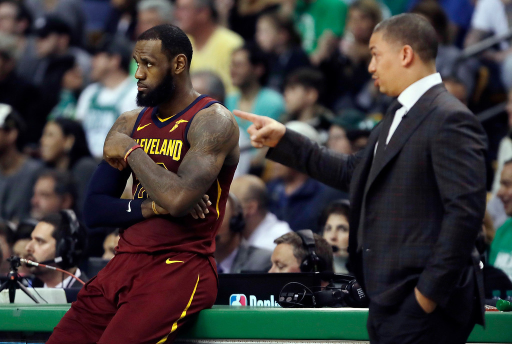 . Cleveland Cavaliers coach Tyronn Lue, right, speaks to LeBron James during a timeout in the first half in Game 2 of the  team\'s NBA basketball Eastern Conference finals against the Boston Celtics on Tuesday, May 15, 2018, in Boston. (AP Photo/Charles Krupa)