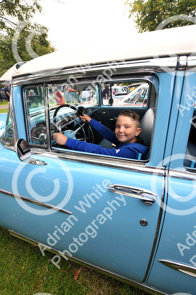 Skewen Motor Club Classic Car show.....annual classic car show... at Gnoll Park Harley Spiller aged 8 behind the wheel of a 1955 Chevrolet Bel Air. BYLINE - www.adrianwhitephotography.co.uk