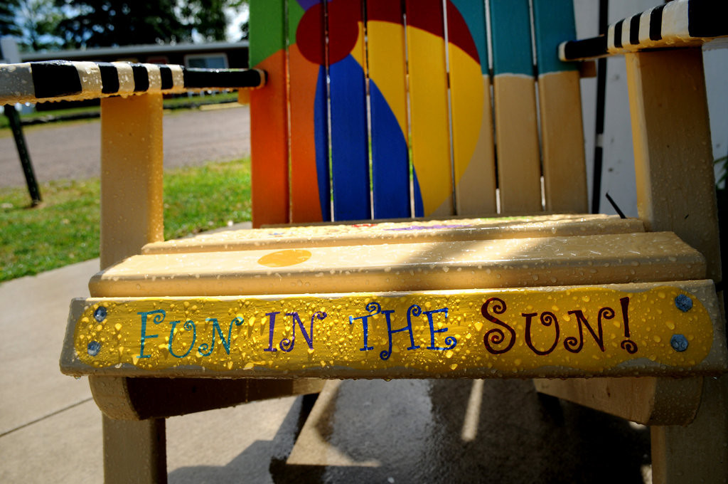 ". A chair titled ""Fun in the Sun\"" sat covered in rain in front of Cotton Candy Ice Cream Shop in Center City, Minnesota Friday July 26, 2013. (Pioneer Press: Jean Pieri)"