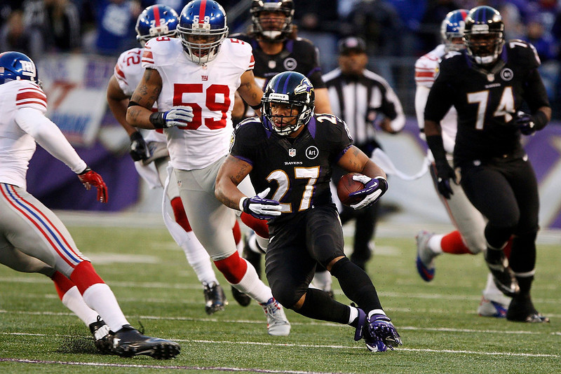 . Baltimore Ravens running back Ray Rice (27) runs against the New York Giants during the first half of their NFL football game in Baltimore, Maryland, December 23, 2012. REUTERS/Jonathan Ernst