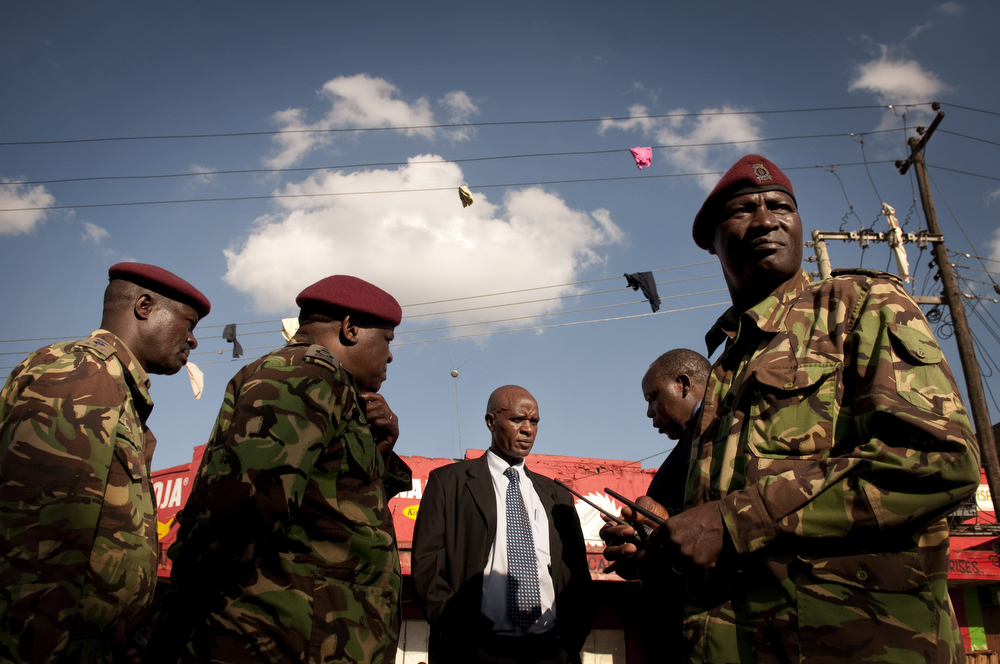 . Clothing hangs from a power line as members of Kenya\'s General Service Unit (GSU) discuss two improvised explosive devices (IED) which went off in Gikomba market on May 16, 2014 in Nairobi, Kenya. Two improvised explosive devices (IED) were activated, killing several people and injuring more than 70. One person has been apprehended as a suspect in the attack. (Photo by Christena Dowsett/Getty Images)