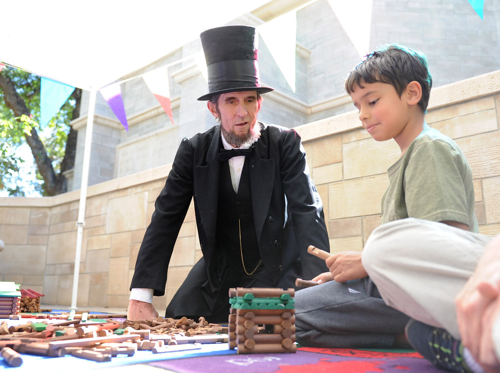 . (John Valenzuela/Staff Photographer)  The A.K Smiley Library in Redlands held their 10th Annual Family Day on Saturday, Oct. 5, 2013. The annual event featured Abraham Lincoln impersonator Robert Broski, author & illustrtor Debra Frasier and a free book for each child in attendance.