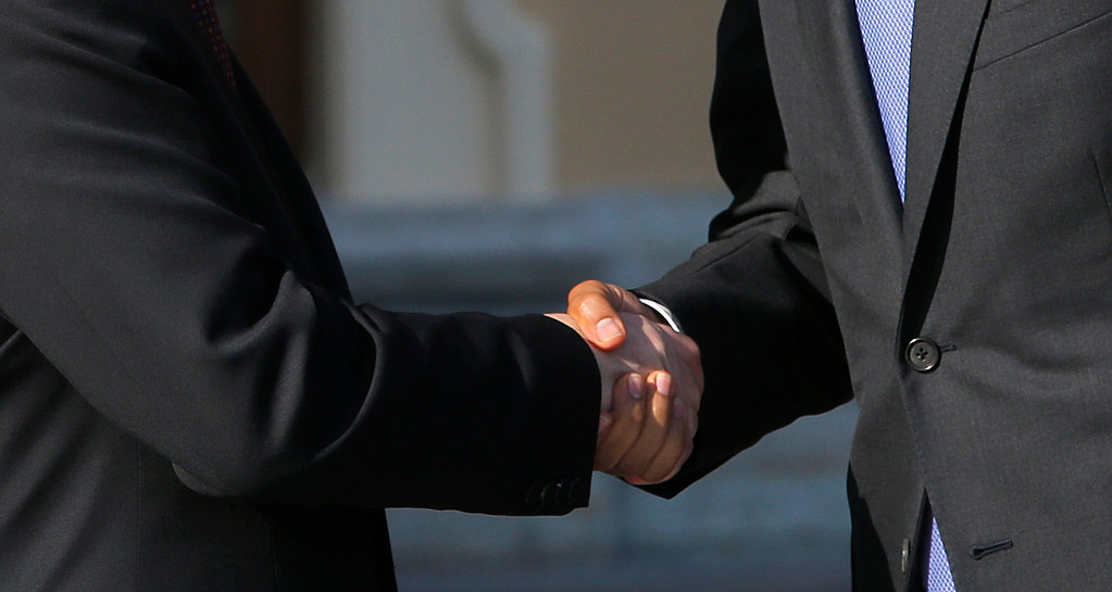 . U.S. President Barack Obama, right, shakes hands with Russia\'s President Vladimir Putin during arrivals for the G-20 summit at the Konstantin Palace in St. Petersburg, Russia on Thursday, Sept. 5, 2013.  (AP Photo/Dmitry Lovetsky)