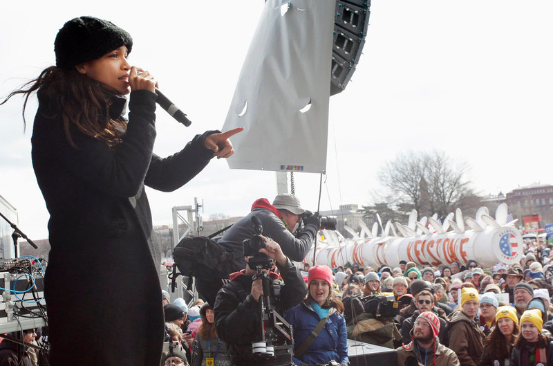 . Actress Rosario Dawson (L) addresses the crowd during a rally against the Keystone XL pipeline in Washington, February 17, 2013. The TransCanada Corp pipeline would link the oil sands of northern Alberta, the world\'s third largest crude resource, to refineries and ports in Texas. Environmentalists say approval of the pipeline will encourage more development in the oil sands, where extraction is carbon intensive, leading to greater greenhouse gas emissions. REUTERS/Richard Clement
