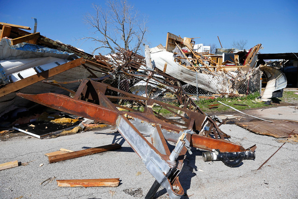 . A mobile home frame is pictured between an overturned mobile home at left, and a tornado-damaged mobile home at right, in Sand Springs, Okla., Thursday, March 26, 2015. Gov. Mary Fallin declared a state of emergency for 25 Oklahoma counties that were hit hardest by the storm. (AP Photo/Sue Ogrocki)