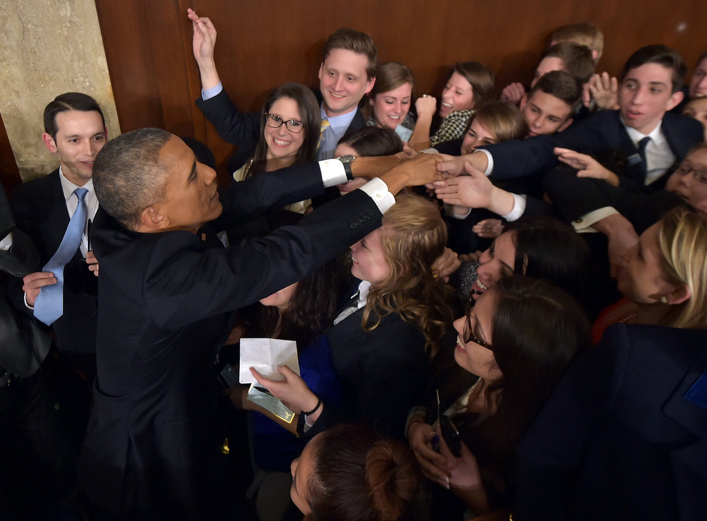 . President Barack Obama shakes hands after delivering the State of the Union address before a joint session of Congress on Tuesday, Jan. 20, 2015, on Capitol Hill in Washington. (AP Photo/Mandel Ngan, Pool)
