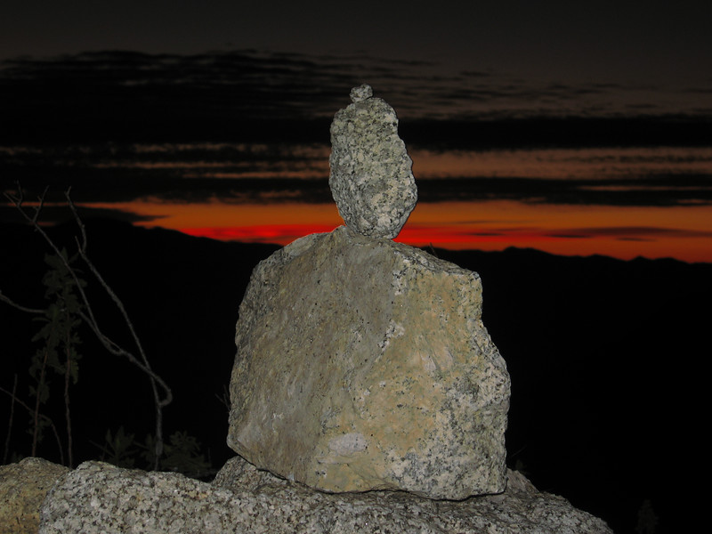 rock art with pre-dawn colors to the east