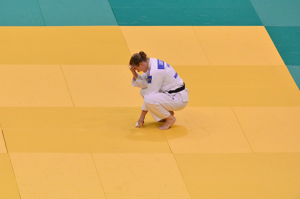 . France\'s Lucie Louette shows her dejection after losing to Cuba\'s Kaliema Antomarchi during the women\'s 78kg category of the IJF World Judo Championship in Rio de Janeiro, Brazil, on August 29, 2013. YASUYOSHI CHIBA/AFP/Getty Images
