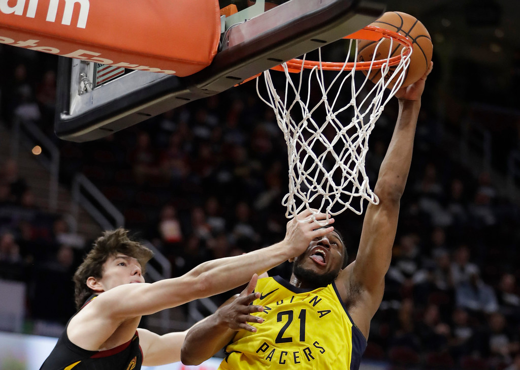 . Indiana Pacers\' Thaddeus Young, right, drives to the basket against Cleveland Cavaliers\' Cedi Osman, from Turkey, in the second half of Game 1 of an NBA basketball first-round playoff series, Sunday, April 15, 2018, in Cleveland. Osman was called for a foul. (AP Photo/Tony Dejak)
