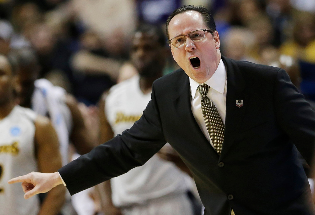 . Wichita State head coach Gregg Marshall shouts from the sideline against Cal Poly during the first half of a second-round game in the NCAA college basketball tournament Friday, March 21, 2014, in St. Louis. (AP Photo/Charlie Riedel)