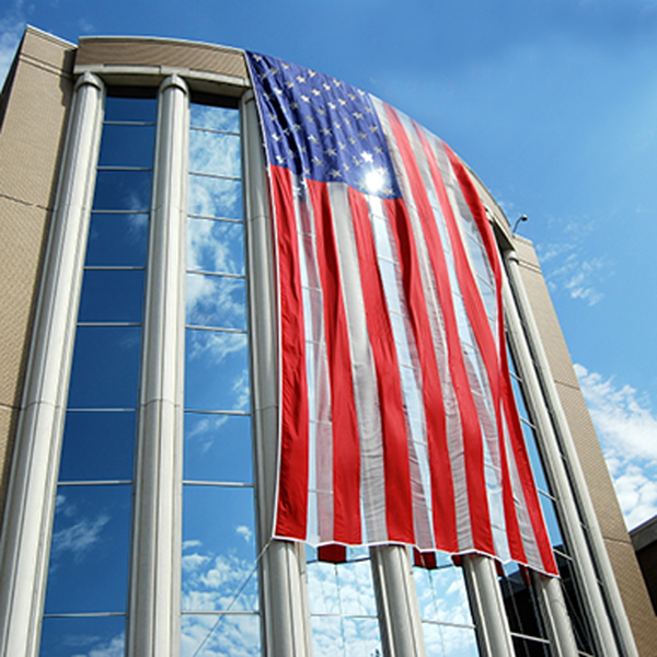 """. This 60-foot American flag was draped Friday outside the west wing of the Oakland County Circuit Court building, 1200 N. Telegraph Road, in honor of those remembered during Labor Day and Patriot�s Day. The flag will remain up through the Twelfth anniversary of the 9/11 terror attacks. County Executive L. Brooks Patterson said the flag is a token of the county\'s appreciation for the sacrifices made by workers, first responders, and men and women in the military who \""""have given their blood, sweat and tears to build and protect the greatest nation on earth.�"""