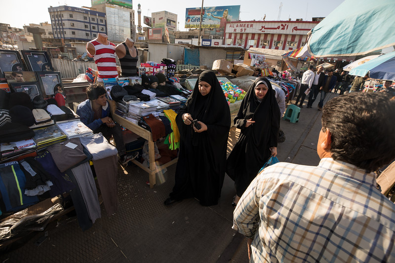 Clothing stalls cluttering a canal bridge in central Basra, Southern Iraq.