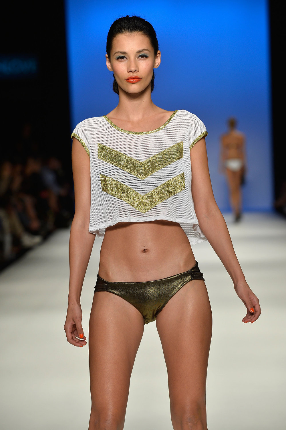 . A model showcases designs by maidenlove on the runway at the Group Swim show during Mercedes-Benz Fashion Week Australia Spring/Summer 2013/14 at Carriageworks on April 8, 2013 in Sydney, Australia.  (Photo by Stefan Gosatti/Getty Images)
