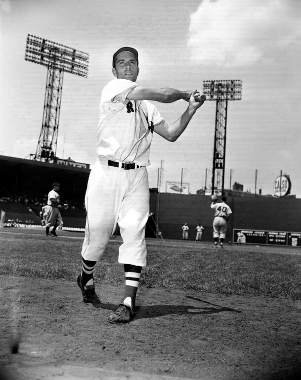 . FILE - In this June 4, 1952, file photo, Jim Piersall of the Boston Red Sox poses at Fenway Park in Boston, Ma., before a game against the Cleveland Indians. Piersall, who bared his soul about his struggles with mental illness in his book �Fear Strikes Out,� has died. The Boston Red Sox, for whom Piersall played for seven of his 17 seasons in the majors, said Piersall died Saturday, June 3, 2017, at a care facility in Wheaton, Ill., after a monthslong illness. (AP Photo/P.J. Carroll, File)