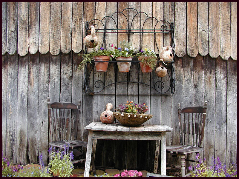 Interesting scene at Erin's Meadow.  I love the way they use antiques and rustics together with their herbs for decorating.