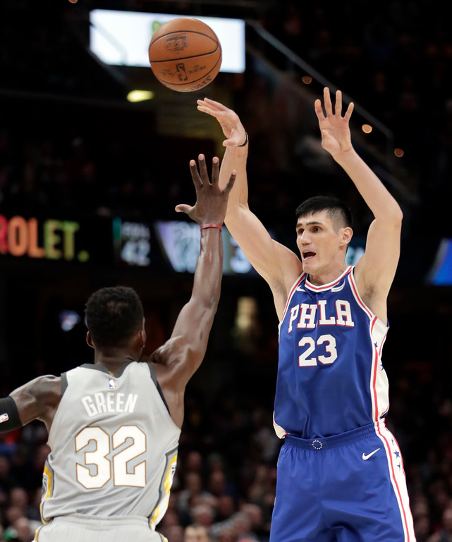 . Philadelphia 76ers\' Ersan Ilyasova (23), from Turkey, shoots over Cleveland Cavaliers\' Jeff Green (32) in the second half of an NBA basketball game, Thursday, March 1, 2018, in Cleveland. (AP Photo/Tony Dejak)