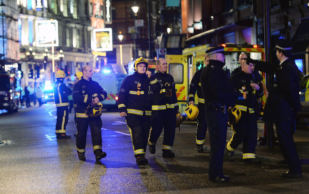 . Police and rescue services at the scene of an apparent balcony collapse at the Apollo Theatre on Shaftsbury Avenue in London, Britain, 19 December 2013. 20 to 40 people were injured according to first estimates by authorities.  EPA/ANDY RAIN