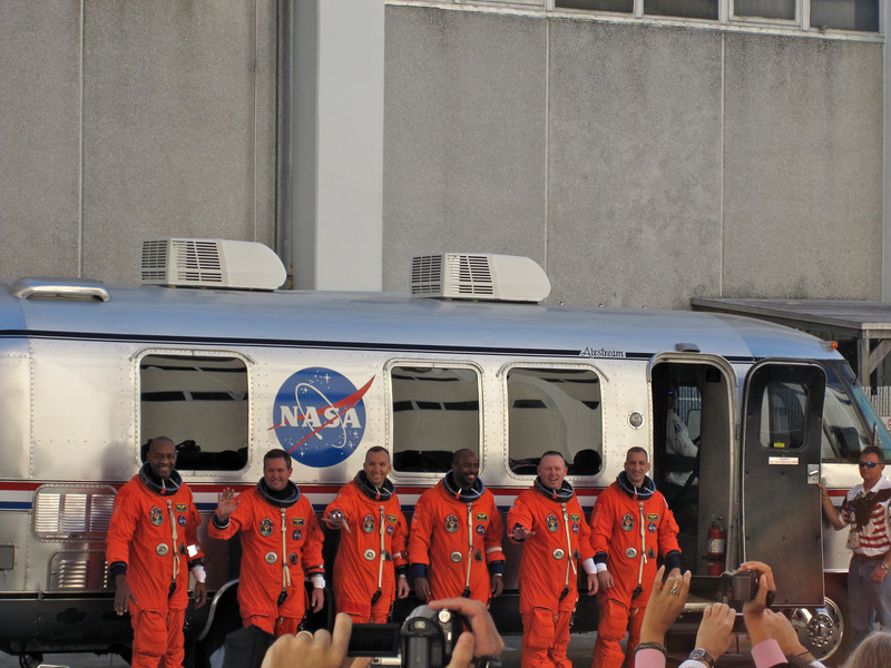 The Atlantis crew pauses in front of the Astrovan for a quick photo. Photo by Jim Lovett