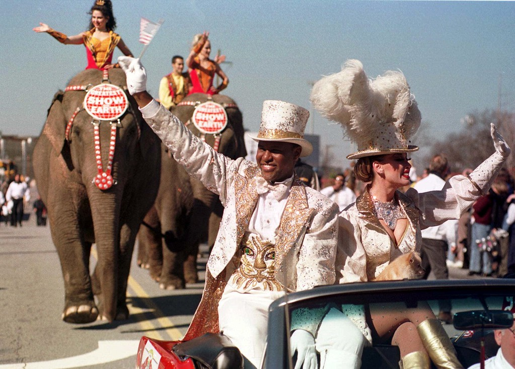 . Ringmaster for Ringling Bros. and Barnum & Bailey circus Jonathan Lee Iverson and Catherine Hanneford lead a parade through downtown Atlanta on Monday, Feb. 21, 2000.  This marks the first return for the circus to Atlanta in some 80 years. (AP Photo/Alan Mothner