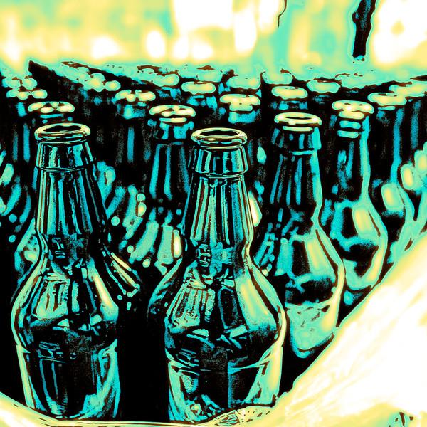 Stacked empty beer bottles