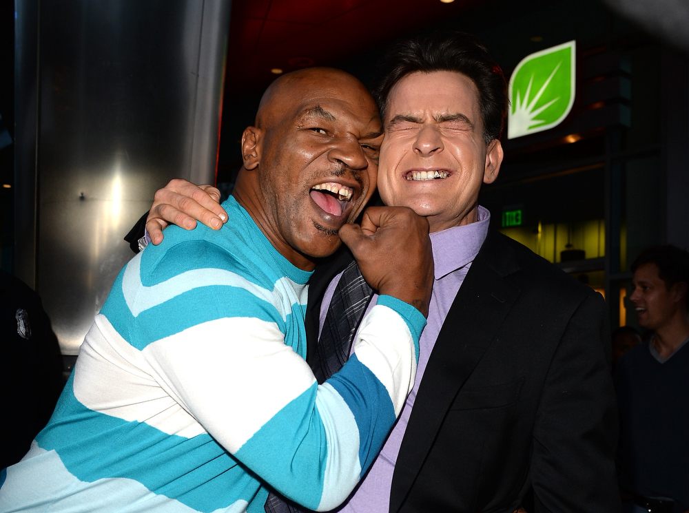 """. Actors Mike Tyson (L) and Charlie Sheen arrive at the Dimension Films\' \""""Scary Movie 5\"""" premiere at the ArcLight Cinemas Cinerama Dome on April 11, 2013 in Hollywood, California.  (Photo by Jason Merritt/Getty Images)"""