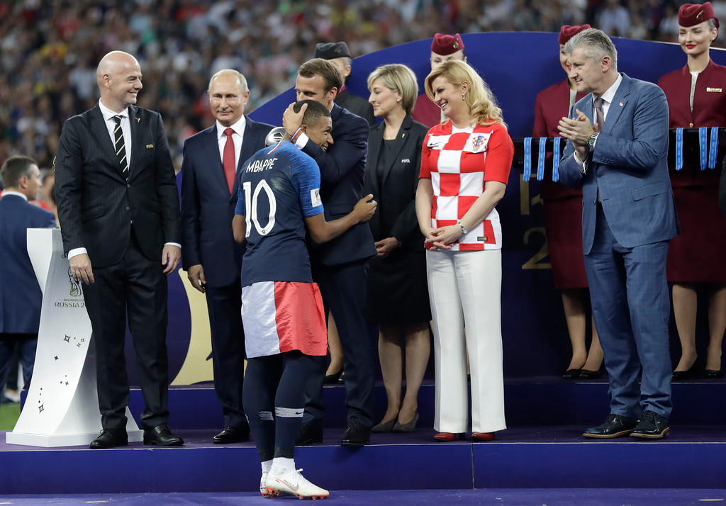 . French President Emmanuel Macron greets France\'s Kylian Mbappe who was awarded the young player of the tournament award after the final match between France and Croatia at the 2018 soccer World Cup in the Luzhniki Stadium in Moscow, Russia, Sunday, July 15, 2018. France won the final 4-2. (AP Photo/Matthias Schrader)