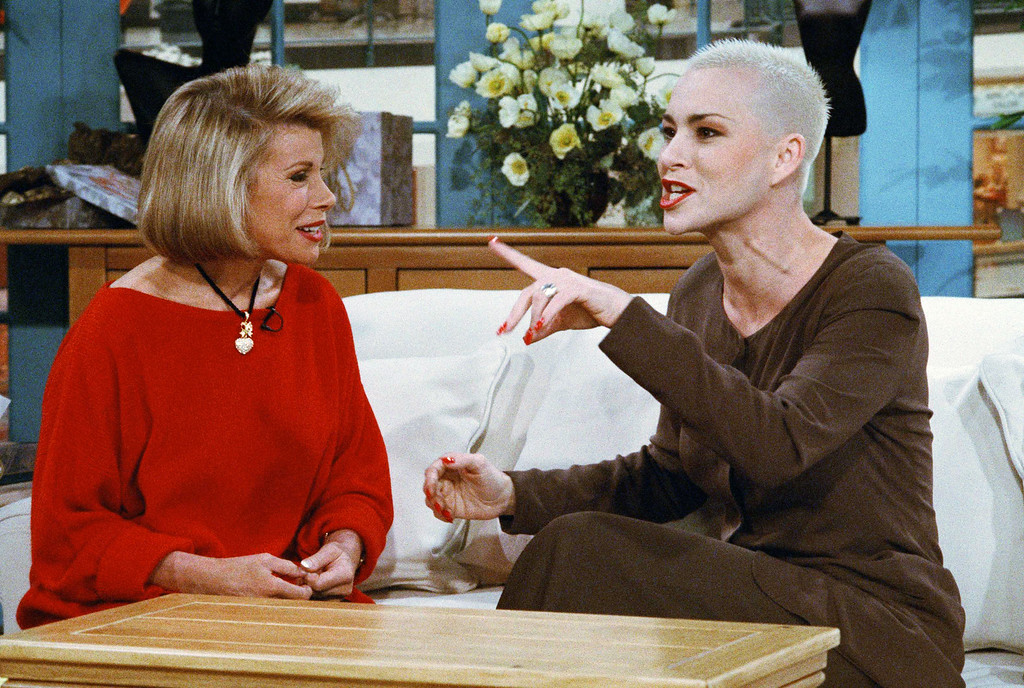 """. Television host Joan Rivers, left, talks with diet and fitness advocate Susan \""""Stop the Insanity\"""" Powter during taping of Rivers new show \""""Can We Shop,\"""" in New York, Jan. 13, 1994. Rivers\' newest endeavor, a one-hour home shopping show, premieres on 118 stations reaching 92 percent of the nation. \""""We\'ve really just taken \'The Joan Rivers Show\' and QVC and put them in a blender,\"""" she said. (AP Photo/Marty Lederhandler)"""
