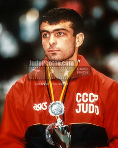 1989 Belgrade Worlds 891015D07:  Amiran Totikashvili of Russia stands wearing his 60kgs gold medal and holding the special cup he received .....