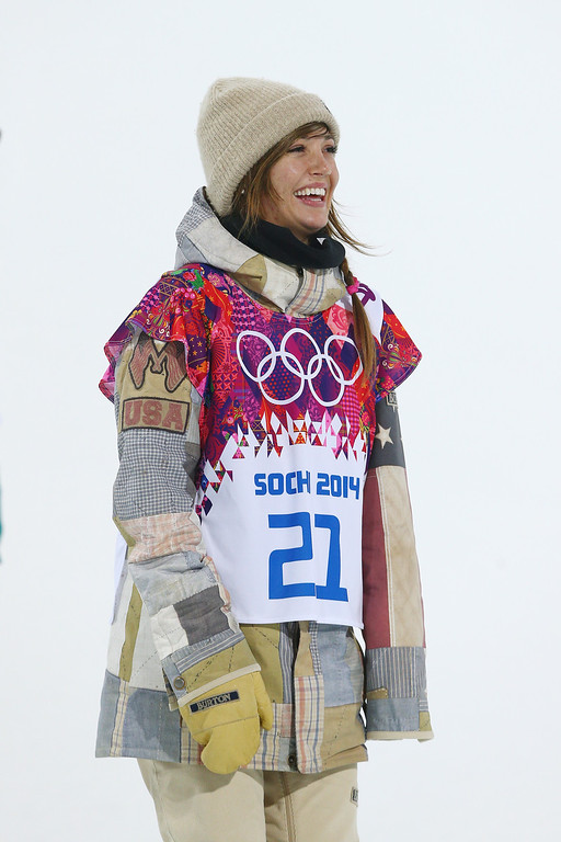 . Gold medalist Kaitlyn Farrington of the United States celebrates during the flower ceremony for the Snowboard Women\'s Halfpipe Finals on day five of the Sochi 2014 Winter Olympics at Rosa Khutor Extreme Park on February 12, 2014 in Sochi, Russia.  (Photo by Cameron Spencer/Getty Images)