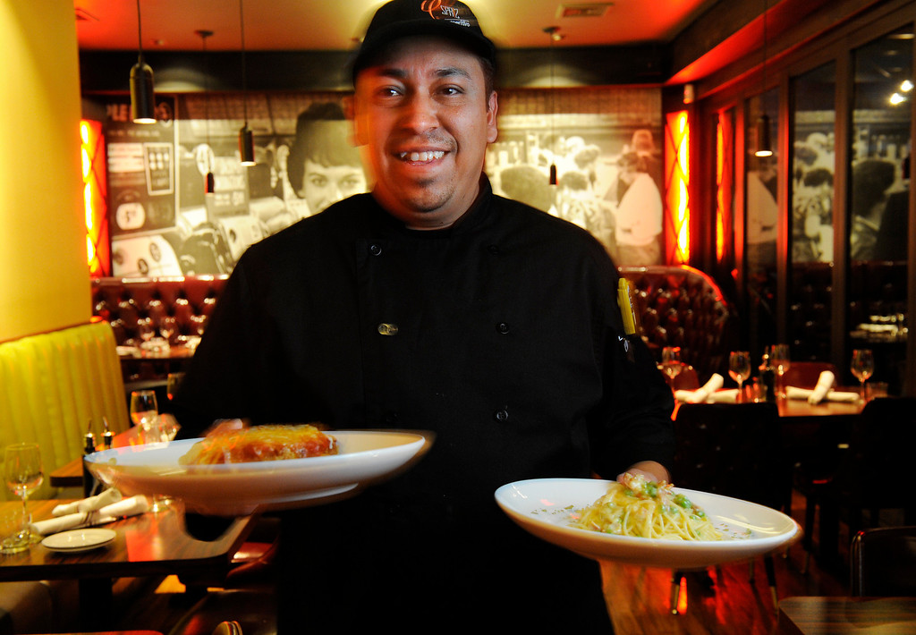 . Dining review of the newly remodeled Gaetano\'s in NW Denver at Tejon and W. 38th Ave on Tuesday, December 4, 2012.   Chef de cuisine is Daniel Ramirez who has joined Gaetano\'s after working  at Pagliacci\'s.  He was holding a lasagna and pasta carbonara.  Cyrus McCrimmon, The Denver Post