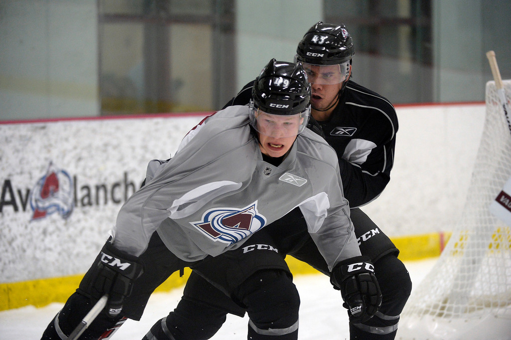 . Mikael Tam (45) and Gabriel Desjardins (49) battle for the puck  on the first day of Avalanche rookie camp September 8, 2013 at Family Sports. (Photo by John Leyba/The Denver Post)