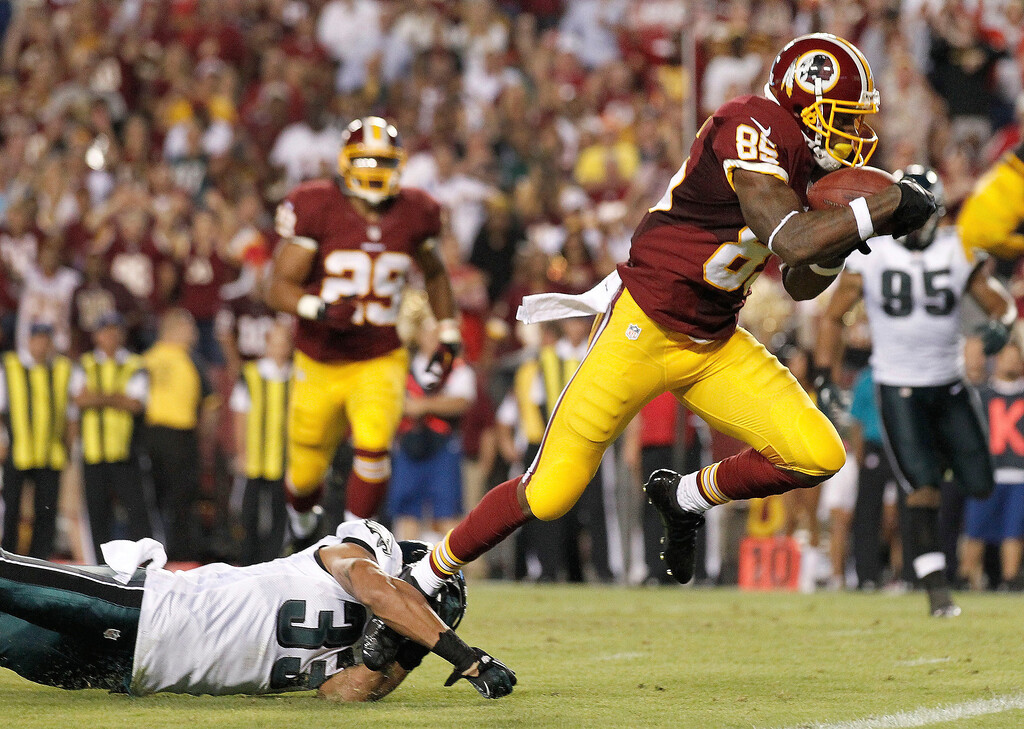 . Washington Redskins wide receiver Leonard Hankerson, right, breaks a tackle by Philadelphia Eagles cornerback Jordan Poyer as he heads toward the end zone for a touchdown during the second half of an NFL football game in Landover, Md., Monday, Sept. 9, 2013. (AP Photo/Alex Brandon)
