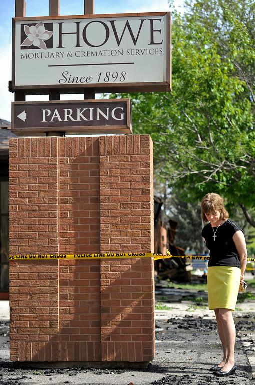 . Funeral Director Jan Sciacca reacts to the damage caused by an early morning fire, Monday, May 28, 2013, at Howe Mortuary and Cremation Services in Longmont. (Matthew Jonas/Times-Call)