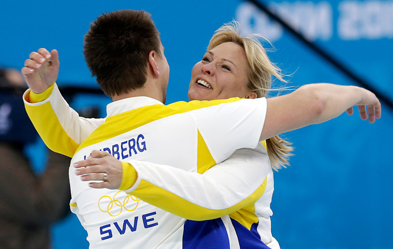 . Sweden\'s men\'s curling coach Eva Lund, right, celebrates with Fredrik Lindberg, left,  after they beat China to win the bronze in the men\'s curling game at the 2014 Winter Olympics Friday, Feb. 21, 2014, in Sochi, Russia. (AP Photo/Wong Maye-E)