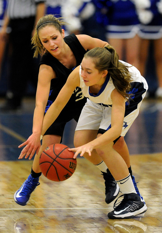 . PARKER, CO. - FEBRUARY 15: Ranch junior guard Sarah Powner (3) pressured Titans guard Kristen Gallagher (3) in the second half. The Highlands Ranch High School girls\'s basketball team defeated Legend 76-31 Friday night, February 15, 2013. Falcon\'s coach Caryn Jarocki earned her 500th career win. (Photo By Karl Gehring/The Denver Post)