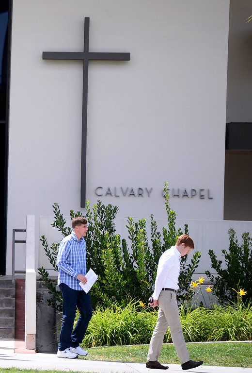 . People leave a memorial for April Jace at Biola University\'s Calvary Chapel Tuesday, May 20, 2014 after Los Angeles Police said they arrested actor Michael Jace on suspicion that he shot and killed his wife. April was a financial aid counselor at the La Mirada college.  (Photo by Sarah Reingewirtz/Pasadena Star-News)