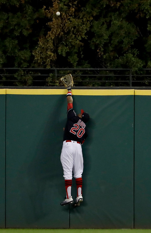 . Cleveland Indians left fielder Rajai Davis can\'t get a glove on a home run by Chicago Cubs\' Dexter Fowler during the first inning of Game 7 of the Major League Baseball World Series Wednesday, Nov. 2, 2016, in Cleveland. (AP Photo/Matt Slocum)