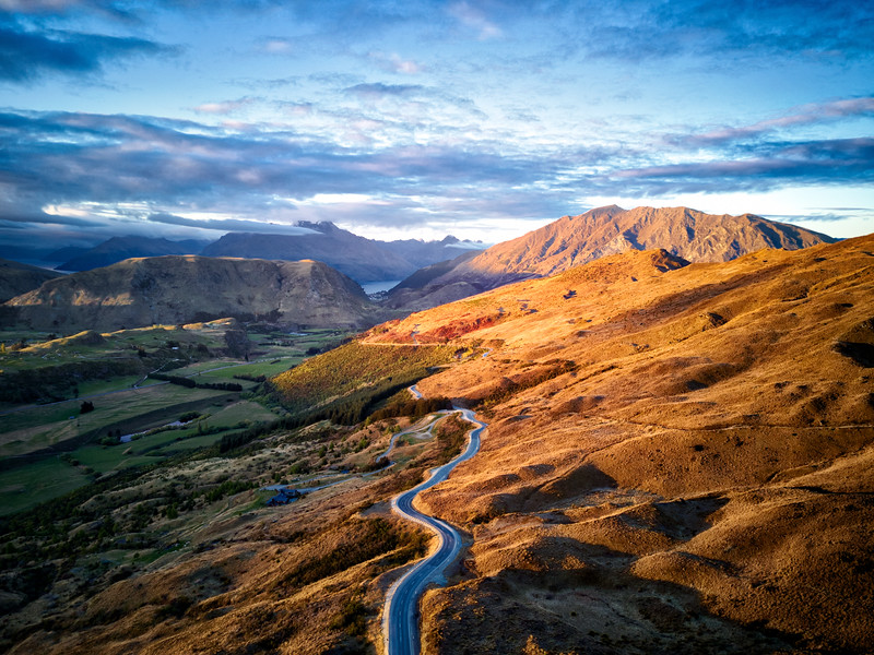 Drone shot from near Coronet Peak looking back toward Queenstown.  You can see the town nestled along the lake in the distance.