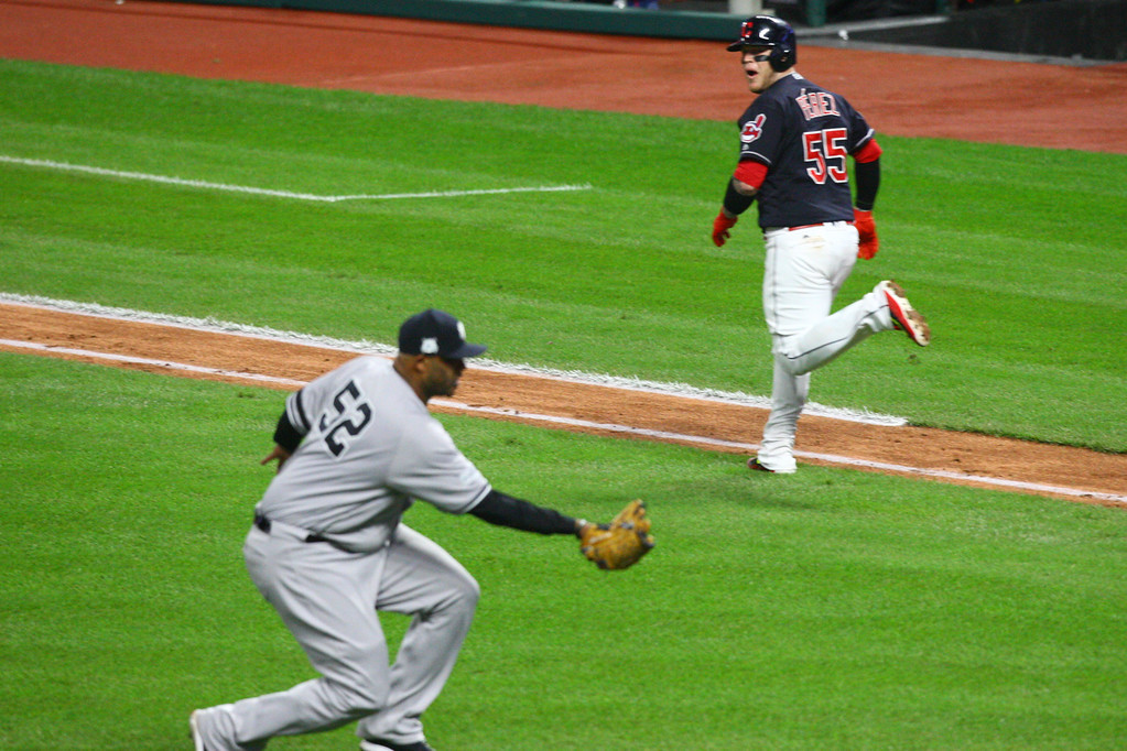 . David Turben - The News-Herald 2017 - Baseball - ALDS Game 5 Quick Pics.  Indians catcher Roberto Perez (55) watches as Yankees pitcher CC Sabathia (52) catches his bunt which he had popped into the air.