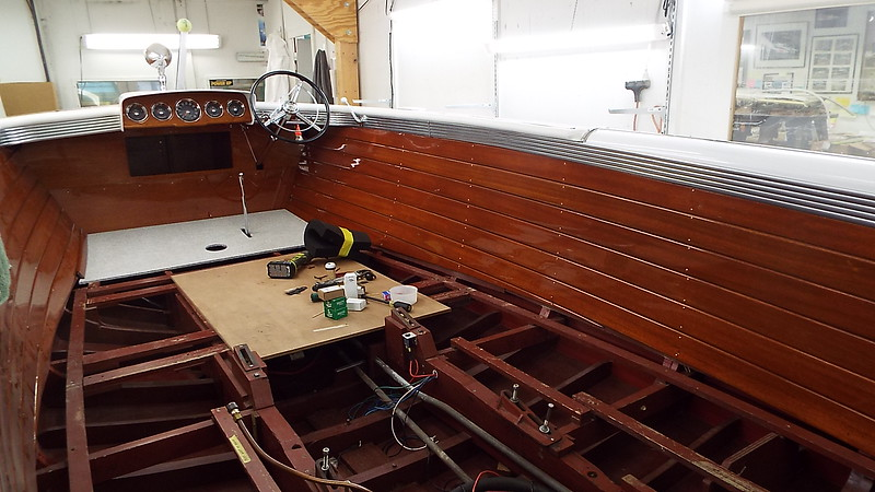 Starboard liner and storage locker installed. All new varnish and new brass fasteners.