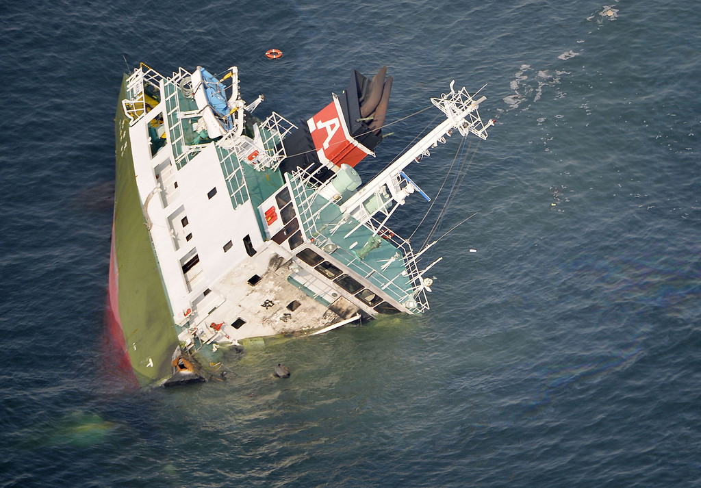. The Shoko Maru, a 998-ton tanker, sinks after it exploded in waters off Himeji port, western Japan, Thursday, May 29, 2014. Japan Coast Guard said the Japanese oil tanker exploded Thursday, leaving one of the eight people aboard missing. (AP Photo/Kyodo News)