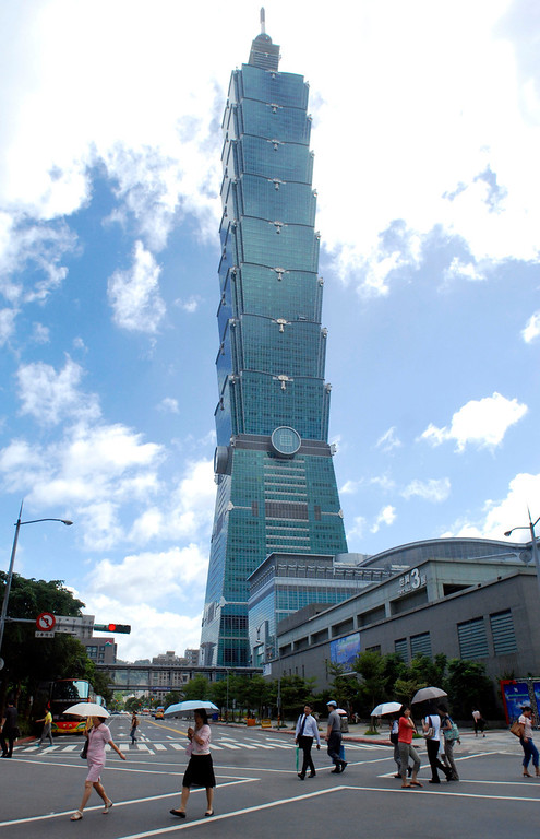 . In this Sept. 22, 2008 file photo, pedestrians cross a road by the side of Taipei 101 in Taipei. Taiwan. According to the nonprofit Council on Tall Buildings and Urban Habitat, Taipei 101 will be the fourth tallest completed building in the world, with a height measured at 1,667 feet, once New York\'s 1 World Trade Center, with a height of 1,776 feet, is completed. (AP Photo/Chiang Ying-ying, File)