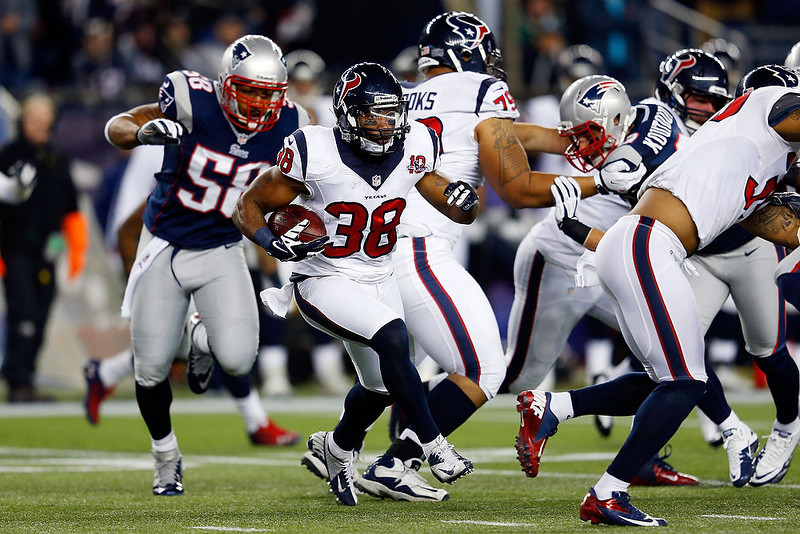. Danieal Manning #38 of the Houston Texans runs with the ball against the New England Patriots during the 2013 AFC Divisional Playoffs game at Gillette Stadium on January 13, 2013 in Foxboro, Massachusetts.  (Photo by Jim Rogash/Getty Images)