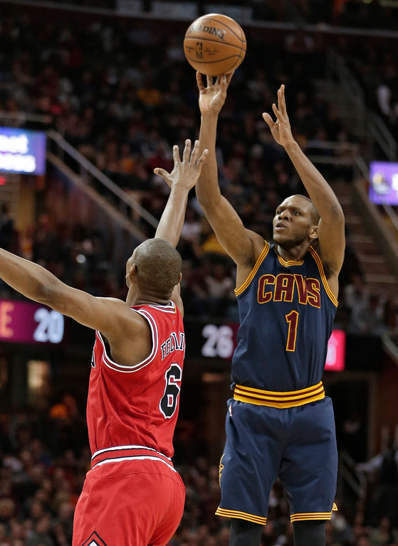 . Cleveland Cavaliers\' James Jones (1) shoots over Chicago Bulls\' Cristiano Felicio (6) during the second half of an NBA basketball game, Saturday, Feb. 25, 2017, in Cleveland. (AP Photo/Tony Dejak)