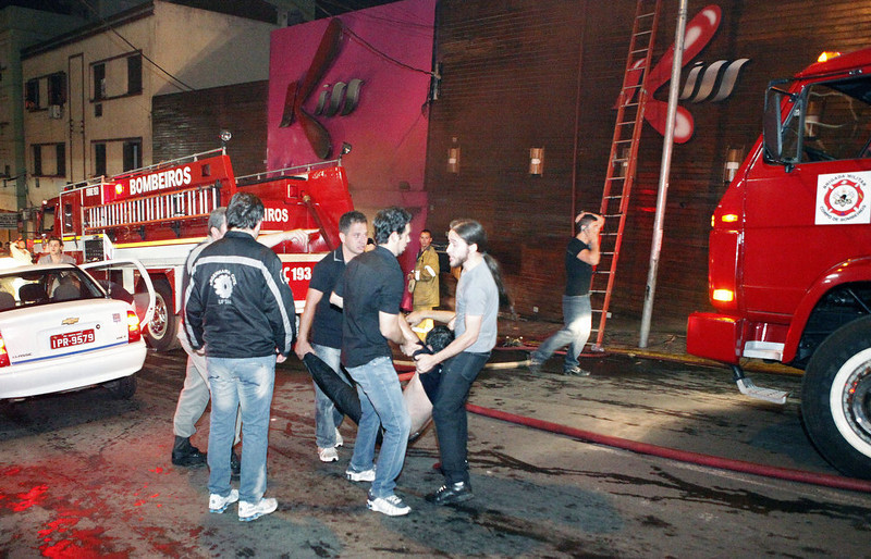 . A victim is carried after a fire at a nightclub in Santa Maria, 550 Km from Porto Alegre, southern Brazil on January 27, 2012. More than 150 people died early Sunday when a fire tore through a nightclub in the southern Brazilian city of Santa Maria during a boisterous student party, police said. Brazilian President Dilma Rousseff interrupted her visit to Chile.  LAURO ALVES/AFP/Getty Images